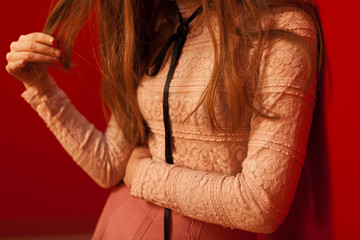 woman with pink lace shirt