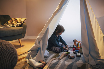 Boy Playing in Tent