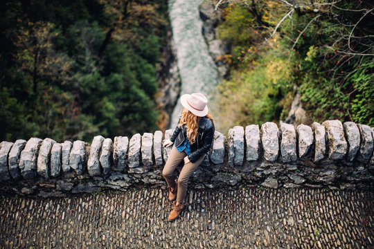 alone woman on the old bridge