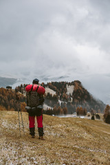 male hiker in autumnal mountain landscape covered in clouds
