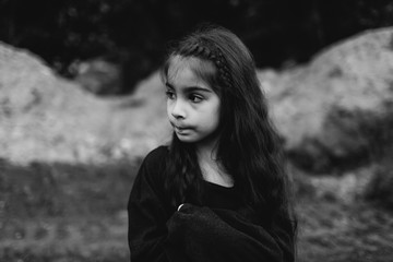 Thoughtful little girl in a black sweater