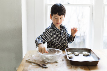 Young boy making chocolate chip cookies