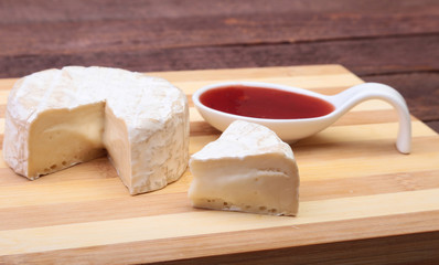 Cheese with white mold. Camembert or brie type with Cranberry sauce.. Healthy breakfast.