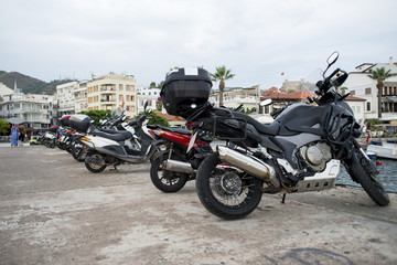A number of  motorcycle parked in rows