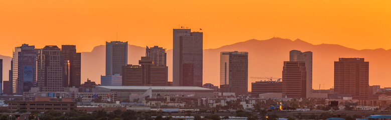skyline of downtown Phoenix Arizona shot from Sky Harbor Airport with the famous Camelback Mountain at sunset