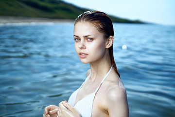 Beautiful young woman is resting on the sea, summer, ocean