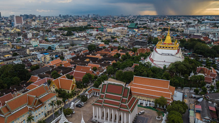 'Golden Mountain '  Wat Saket Ratcha Wora Maha Wihan popular Bangkok tourist attraction , Landmarks of bangkok Thailand . In the rain before , topview