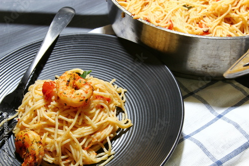 Tomato And Basil Angel Hair Pasta Topped With Spicy Shrimp And