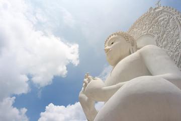 White Buddha in Bright Sky