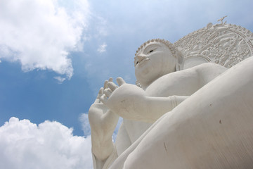 White Buddha in Bright Sky
