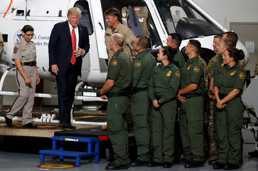 U.S. President Donald Trump greets Border Patrol agents as he tours the U.S. Customs and Border Patrol facility in Yuma, Arizona