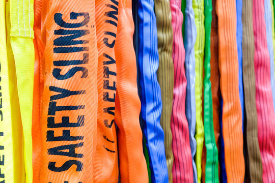 Multicolored of safety sling, Sling for industrial use during safety on industrial factory, construction and logistics, selective focus at safety sling word