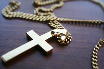 Golden Catholic Cross On Table High Quality