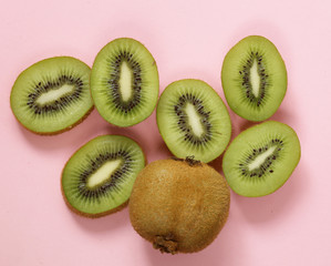 Organic green kiwi fruit sliced into slices