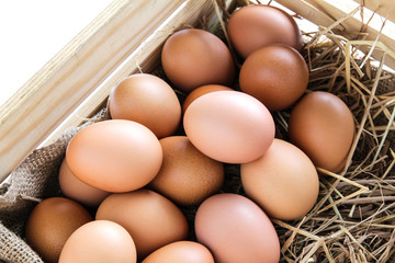 Eggs in wooden box.