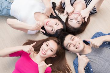 young people lying on floor