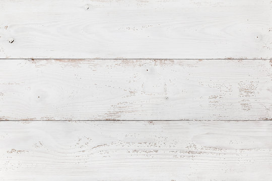 Old wooden board painted white. Light background or texture for your design