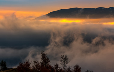fog rise in mountains at sunrise