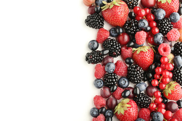 Ripe and sweet berries on white background