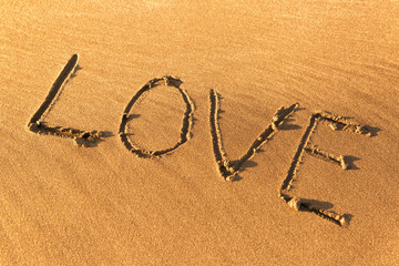 "The inscription ""Love"" on the sand"