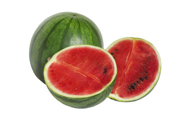 Ripe large whole watermelon with cut juicy slices
