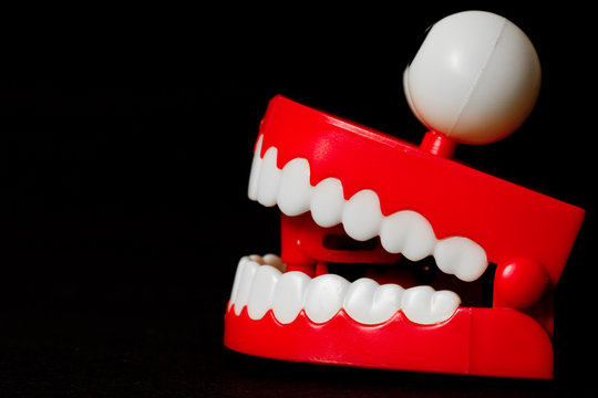 Chattering teeth toy from the side looking left mouth open