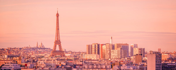 Fototapete - Panoramic skyline of Paris with the Eiffel tower at sunset, Montmartre in the background, France and Europe city travel concept
