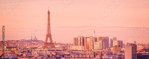 Wall mural Panoramic skyline of Paris with the Eiffel tower at sunset, Montmartre in the background, France and Europe city travel concept