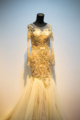 Wedding dress gown on mannequin in bridal gown. Bride's morning wedding preparation concept