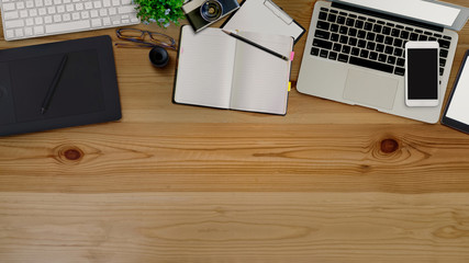 Top view of wood office desk table with office supplies.