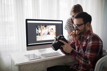 Beautiful woman and attractive man doing design work