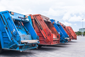 Several cars parked garbage truck for transport to garbage collection.