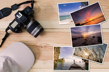 Old camera, cap and stack of photos on wooden background, photography hobby lifestyle concept