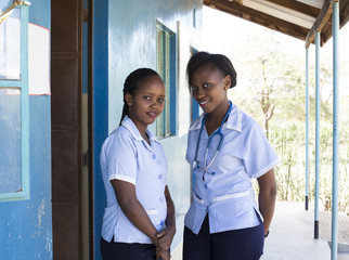 Portrait of two smiling nurses. Kenya, Africa.