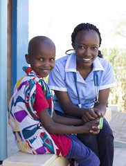 Portrait of Nurse and young girl in clinic. Kenya, Africa.