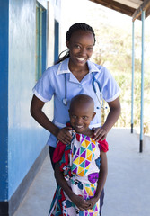 Portrait of Nurse and young girl in clinic. Kenya, Africa