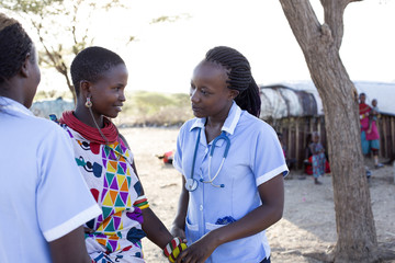 Nurses examing patient in rural village. Kenya, Africa