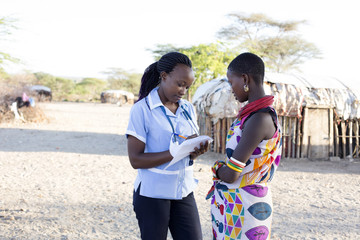 Nurse examing patient in rural village. Kenya, Africa