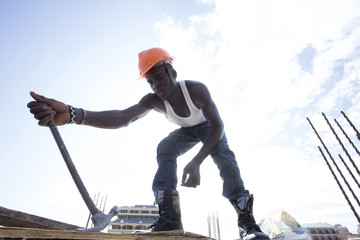 Man working on construction site. Kenya, Africa