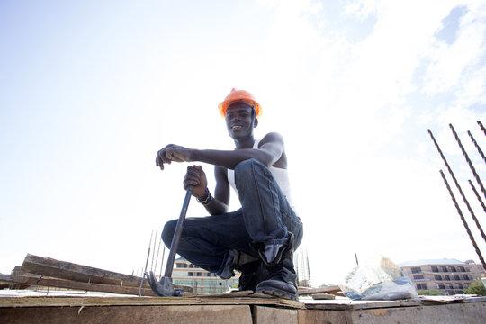 Man working on construction site. Kenya, Africa.