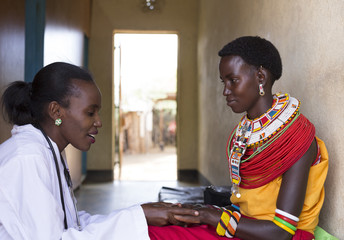 Doctor with patient (Samburu tribal woman). Maternity clinic. Samburu, Kenya, Africa.