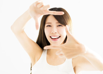 young woman hands making frame gesture .