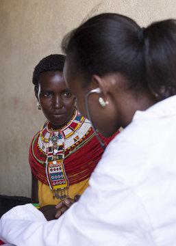 Feamle Doctor examing female Samburu patient. Kenya, Africa