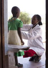 Female Doctor examining child (female).