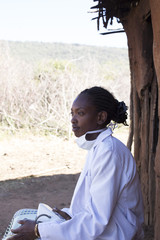 Female Doctor working in Maasai village. Kenya, Africa