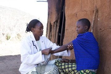Doctor examining female patient. Kenya,  Africa