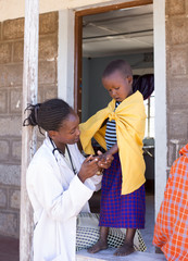 Doctor examing child (girl). Kenya, Africa.
