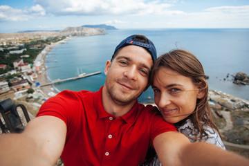 Beautiful couple making selfie in instagram in Sudak, Russia