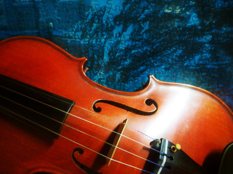 The half front side of violin was put at the bottom left of grunge surface board ,in abstract art design,vintage style,blurry light around.