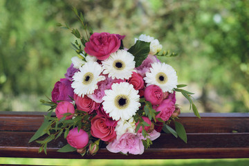 Gerbera, peonies and pink roses in a large wedding bridal arrangement, with blurred background